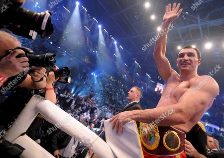 Ukrainian World Champion Vladimir Klitschko (r) Celebrates After His Victory Over Us Boxer Hasim Rahman (not in the Picture) During Their Ibo and Wbo Heavyweight Titles Bout at Sap Arena in Mannheim Germany on 13 December 2008 Germany Manheim