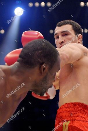 Ukrainian World Champion Vladimir Klitschko (r) Exchanges Punches with Us Boxer Hasim Rahman During Their Ibo and Wbo Heavyweight Titles Bout at Sap Arena in Mannheim Germany on 13 December 2008 Klitschko Beat His Opponent Rahman with a Knock-out in the Seventh Round Germany Manheim