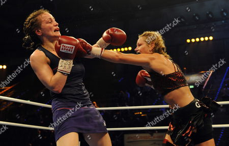 Canadian Jeannine Garside (r) and Germany's Ina Menzer (l) During Their Featherweight Wbc Wbo and Wibf Belt Title Fight at the Universum Champions Night in the Porsche Arena Stuttgart Germany on 03 July 2010 Garside Won on a Points Decision at the End of the 10 Round Fight Germany Stuttgart
