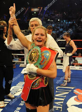 Canadian Jeannine Garside (c) Reacts After Defeating Germany's Ina Menzer (not Pictured) During Their Featherweight Wbc Wbo and Wibf Belt Title Fight at the Universum Champions Night in the Porsche Arena Stuttgart Germany on 03 July 2010 Garside Won on a Points Decision at the End of the 10 Round Fight Germany Stuttgart