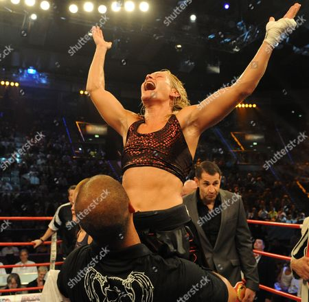 Canadian Jeannine Garside (c) Reacts After Defeatomg Germany's Ina Menzer (not Pictured) During Their Featherweight Wbc Wbo and Wibf Belt Title Fight at the Universum Champions Night in the Porsche Arena Stuttgart Germany on 03 July 2010 Garside Won on a Points Decision at the End of the 10 Round Fight Germany Stuttgart