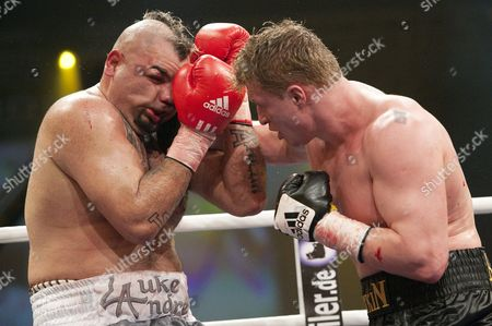 Mexican Boxer Javier Mora (l) Receives a Punch From Russian Boxer Alexander Povetkin During Their 10 Round Bout in Berlin Germany 13 March 2010 Povetkin Won in the 5th Round Through Technical Knockout Germany Berlin