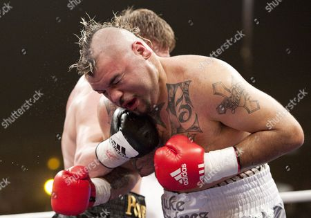 Stock Image of Mexican Boxer Javier Mora (r) Receives a Punch From Russian Boxer Alexander Povetkin During Their 10 Round Bout in Berlin Germany 13 March 2010 Povetkin Won in the 5th Round Through Technical Knockout Germany Berlin