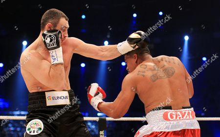 Ukrainian Heavyweight Boxing Title Holder Vitali Klitschko (l) and His Cuban Contender Odlanier Solis Exchange Blows During the First Round of Their Wbc World Heavyweight Championship Fight in Cologne Germany 19 March 2011 Epa/rolf Vennenbernd Germany Cologne