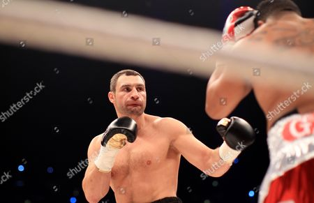 Ukrainian Heavyweight Boxing Title Holder Vitali Klitschko (l) and His Cuban Contender Odlanier Solis During the First Round of Their Wbc World Heavyweight Championship Fight in Cologne Germany 19 March 2011 Germany Cologne