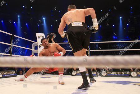 Ukrainian Heavyweight Boxing Title Holder Vitali Klitschko (l) Knocks Down Odlanier Solis of Cuba During the First Round of Their Wbc World Heavyweight Championship Fight in Cologne Germany 19 March 2011 Germany Cologne