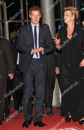 British Prince Harry (l) Arrives with Marion Horn Boss of the Charity Organisation at the Fundraising Event 'Ein Herz Fuer Kinder' (a Heart For Children) in Berlin Germany 18 December 2010 the German Television Channel Zdf and the Newspaper 'Bild' Collected Donations For Children's Charity Organisations in Germany and the Whole World Germany Berlin