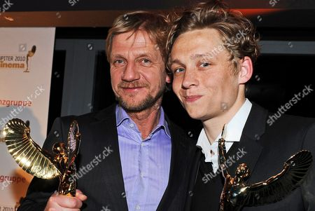 A Picture Made Available on 17 April 2010 Shows German Film Director Soenke Wortmann (l) and Matthias Schweighoefer (r) Posing For Photographs with Their Awards During the Jupiter Award Ceremony at the Puro Sky Lounge in Berlin Germany 16 April 2010 Wortmann Received the Best Director Award For His Movie 'Pope Joan' and Schweighoefer Received the Best Tv Actor Award For His Performance in 'Marcel Reich Ranicki: My Life' the Jupiter Award Winners Are Selected by the Readers of the Magazine 'Cinema' Germany Berlin