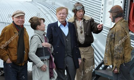 German Actors Rolf Wolter (l-r) Angelica Domroese Otto Sander Tilo Prueckner and Robert Stadlober Stand on the Set During Filming of the Movie 'Bis Zum Horizont Dann Links!' (lit:to the Horizon Then Left!) at the Airfield in Halle/oppin ágermany 01 Aprilá2011 Germany Oppin