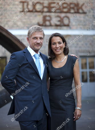 German Director Soenke Wortmann and German Tv Celebrity and Host of the Award Ceremony Anne Will Pose For Photographs in Front of 'Alte Tuchfabrik' ('old Fabric Factory') in Euskirchen Germany 19 August 2009 Wortmann Received the 'Grosser Kulturpreis Der Sparkassen-kulturstiftung Rheinland' ('great Culture Award of the Savings Bank Cultural Foundation in the Rhineland') to Honor His Lifetime Achievement Wortmann who Will Turn 50 on 25 August Received an Amount of 30 000 Euros As Well Germany Euskirchen