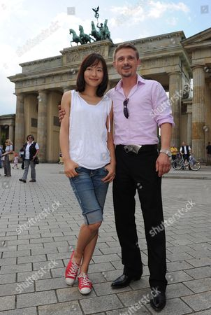 Chinese Actress Jiang Yiyan and German Actor Florian Lukas Pose During a Photocall For the Movie 'I Phone Y(o)u' in Front of the Brandenburg Gate Germany 10 August 2010 the Film Will Be Arriving to the Cinemas in May Or June 2011 Germany Berlin