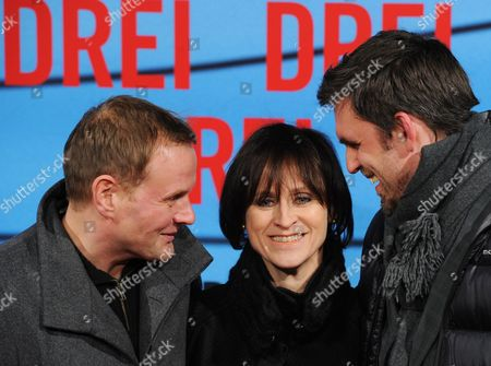 A Picture Made Available on 14 December 2010 Shows (l-r) German Actors and Cast Members Devid Striesow Sophie Rois and Sebastian Schipper Arriving For the Film Premiere 'Three' (drei) Directed by German Film Director Tom Tykwer at the Delphi Cinema in Berlin Germany 13 December 2010 the Movie Will Be Shown in German Film Theaters From 23 December 2010 Germany Berlin