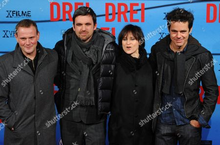 From (l-r) German Actors and Cast Members Devid Striesow Sebastian Schipper Sophie Rois Pose For a Photograph with German Film Director Tom Tykwer As They Arrive For the Film Premiere 'Three' (drei) Directed by German Film Director Tom Tykwer at the Delphi Cinema in Berlin Germany 13 December 2010 the Movie Will Be Shown in German Film Theaters From 23 December 2010 Germany Berlin