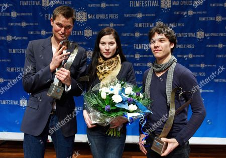 (l-r) German Actor Fabian Hinrichs Austrian Actress Nora Von Waldstaetten and German Actor Sebastian Urzendowsky Hold Their Award As They Pose For Photographs During the Max Ophuls Award Ceremony 2010 in Saarbruecken Germany 23 January 2010 Fabian Hinrichs Received a Special Prize and Nora Von Waldstatten the 'Best Upcoming Actress' Award For Their Roles in 'Schwerkraft' (gravity) Sebastian Urzendowsky Recievd the 'Best Upcoming Actor' Award Germany Saarbruecken