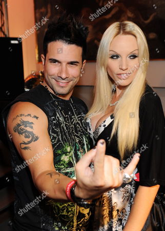 A Picture Dated 30 June 2009 Shows Us Singer Marc Terenzi (l) and Model Gina-lisa Lohfink (r) at the Shocking Shorts Award Ceremony in Munich Germany the Prize is Presented Annually Within the Munich Film Festival by the Channel 13th Street Germany Munich