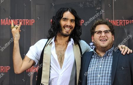 Usáactor/cast Member Jonah Hill (r)áand British Actor/cast Member Russel Brand (l)áarrive For the Premiere of the Film 'Get Him to the Greek'áin Berlin Germany 25 June 2010 the Movie by Us-british Director Nicholas Stoller Opens in German Theaters From 26 August Germany Berlin