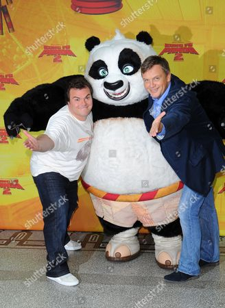 Stock Image of Usáactor Jack Black (l) and German Actor Hape Kerkeling Pose with a Panda Figure During a Photocall at the 'Kung Fu Panda 2' Presentation in Berlin ágermany 07 June 2011 Black Voices the Role of Po in the Movie That Opens in German Theatres on 16 June Germany Berlin