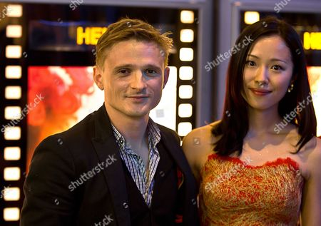 German Actor and Cast Member Florian Lukas and Chinese Actress and Cast Member Yiyan Jiang Pose For a Photograph As They Arrive For Their Film Premiere 'I Phone You' in Berlin Germany 25 May 2011 the Movie Directed by Dantang Will Be Released in German Theatres on 26 May 2011 Germany Berlin