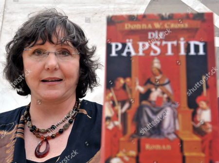 Us Writer Donna W Cross Poses with a Copy of the German Translation of Her Novel 'Pope Joan' During a Press Call at Querfurt Castle Germany 09 August 2008 Cross' Novel is the Basis For the Medieval Spectacle Film 'Pope Joan' Directed by German Filmmaker Soenke Wortmann German Actress Johanna Wokalek Stars the Role of Johanna Von Ingelheim who in the 9th Century Ad Dresses As a Man and is Crowned Pope in Rome the Film is Shot on Locations in the Harz Region North Rhine Westfalia and Morocco Germany Querfurt