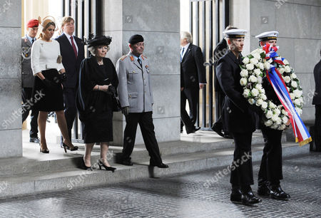 Stock Photo of Queen Beatrix of the Netherlands Crown Prince Willem-alexander and Crown Princess Maxima Accompanied by Deputy Inspector General of Theábundeswehr Guenter Weiler Go to a Wreath-laying Ceremony at the New Guard House in Berlin ágermany 12 April 2011 the Royal Family Started Its State Visit of Germany and Will Stay For Four Days á Germany Berlin