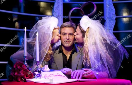 Nina (l)áand Lisa Employees of Madame Tussaud's Kiss the Wax Figure of Us Actor George Clooney Ináberlin Germany 30 July 2010 the Wax Cabinet Has Arranged Clooney's Figure in a Wedding Scene So That Visitors Can Pose in It As Brides Germany Berlin