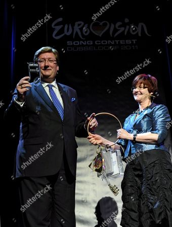 Dirk Elbers (l) First Mayor of Duesseldorf Receives an Oversized Key From the Vice Mayor of Oslo Aud Kvalbein As the Song Contest Weeks Kick Off in Duesseldorf Germany 17 January 2011 a Delegation From Oslo the Former Host of the European Song Contest Attended the Ceremony in Duesseldorf the Final of the Eurovision Song Contest 2011 Will Be Held on 14 May 2011 at the Espritarena in Duesseldorf Germany Duesseldorf