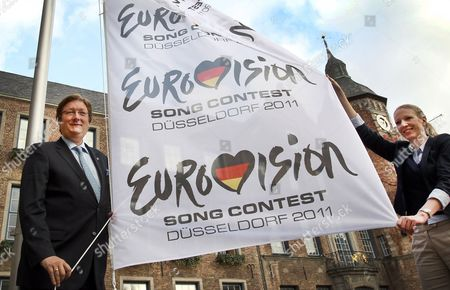 Duesseldorf Lord Mayor Dirk Elbers (l)áflies the Flag For the Eurovision Song Contest 2011 in Duesseldorf Germany 12 November 2010 the Final of the Eurovision Song Contest 2011 Will Be Held on 14 May 2011 at the Espritarena in Duesseldorf Germany Duesseldorf