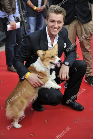Alexej Vorobjov Representing Russia and His Dog Elvis Arrive For the Lord Mayor's Reception the Official Reception For Eurovision Participants and Their Delegations During the Eurovision Song Contest in Duesseldorf Germany 07 May 2011 the Final of the 56th Eurovision Song Contest Takes Place on 14 May 2011 Germany Duesseldorf