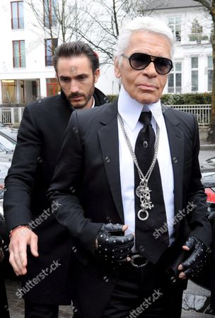 German Fashion Designer Karl Lagerfeld (r) and His Assistant Sebastien Jondeau Are on Their Way to the 'Old Mansion' in Hamburg Germany 16 February 2009 Lagerfeld Will Design the Reception and Lounge Areas of the 'Sophienpalais' a Restaurant and Two 'Alster Mansions' at the New Luxury Neighbourhood 'Sophienterrassen' Along the River Alster Germany Hamburg