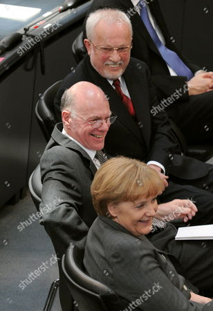 (top-botom) the Last Gdr Prime Minister Lothar De Maiziere President of the German Bundestag Norbert Lammert and German Chancellor Angela Merkel Smile During a Ceremony in Berlin Germany 18 March 2010 German Bundestag Commemorated the 20th Anniversary of the First and Only Free Elections in the Gdr Held on 18 March 1990 Germany Berlin