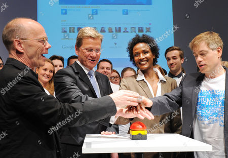 Font Designer Erik Spiekermann (l-r) Germanáforeign Minister Guido Westerwelle Model Waris Dirie and Comedian Michael Mittermeier Open an Online Competition For a Global Human Rights Logo at the Radialsystem in Berlin ágermany 03 May 2011 the Competition is Held by the German Ministry of Foreignáaffairs Germany Berlin