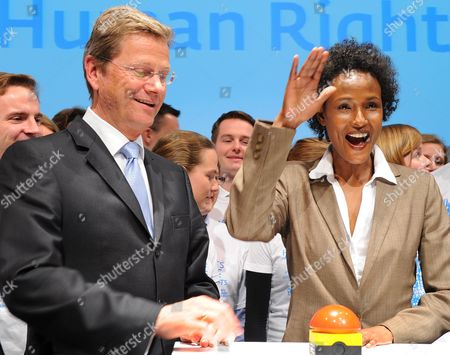 Germanáforeign Minister Guido Westerwelle and Model Waris Dirie Open an Online Competition For a Global Human Rights Logo at the Radialsystem in Berlin ágermany ágermany 03 May 2011 the Competition is Held by the German Ministry of Foreignáaffairs Germany Berlin