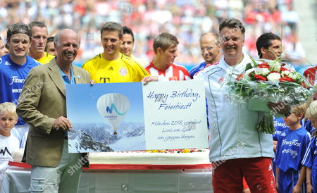 Former Alpine Ski Racer and a Renowned Fashion Designer Willy Bogner (l) Presents Bayern Munich Coach Louis Van Gaal with a Giant Birthday Card in Munich Germany 08 August 2010 Van Gaal Turned 59 Germany Munich