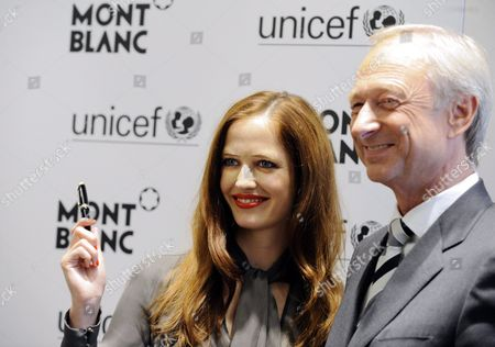 French Actress Eva Green and Lutz Bethge Executive Director of Montblanc International Pose at the Presentation of the New Montblanc Writing Instrument 'Signature For Good' in Hamburg Germany 24 June 2009 the Sale of the Special Edition Supports the Children's Fund Unicef Montblanc Aims to Collect at Least 1 5 Million Dollars For Unicef in the Next 12 Months Germany Hamburg