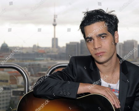 Israeli Singer Aviv Geffen Poses with His Guitar After a Press Conference in Berlin Germany 12 August 2009 Geffen Presented His New Record That Will Be Released on 28 August Germany Berlin
