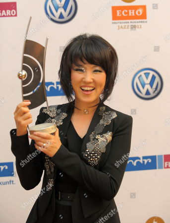 South Korean Singer Youn Sun Nah Poses with His Trophy at the Echo Jazz Awards 2011 in Dresden Germany on 17 June 2011 Germany Dresden