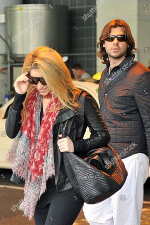 Colombian Singer Shakira and Her Boyfriend Antonio De La Rua Arrive at the Airport in Frankfurt Main Germany 20 September 2009 Shakira Will Present Her Charity Projects For the First Time in Germany at the 'Burda Live' Event in Offenburg on 21 September the Main Focus of Shakira's Charity Work is on Street Kids in Columbia and More Support For Developing Countries in General Germany Frankfurt Main