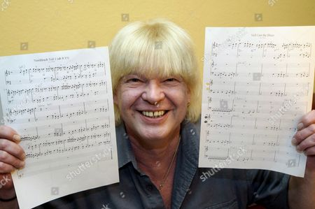 Musician Juergen Winter Poses with the Notes of His Song 'Nordrach' (l) and the Northern Irish Guitarist Gary Moore's Song 'Still Got the Blues' in Sinzig Germany 4 December 2008 the Same Day the Civil Division of Munich's Regional Court Sentenced Rock Star Gary Moore to Pay Compensation to Winter on the Grounds of Plagiarism Additionally Moore who Claims Copyright For the Composition Has to Present Information on the Origin of His Song Juergen Aka Judy Winter was Member of the Band 'Jud's Gallery' in the 1970s at That Time the 12min Song 'Nordrach' was Recorded at a Swr (south West German Public Broadcasting Station) Studio and Also Broadcast on Radio Germany Sinzig