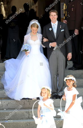 Groom Hubertus Michael Hereditary Prince of Saxony-coburg and Gotha and His Newly Wedded Wife Kelly Jeanne (n?e Rondestvedt) Leave the Church After Their Wedding in Coburg Germany 23 May 2009 Some 400 Guests Many of Which Celebrities and European Aristocrats Attended the Wedding Germany Coburg