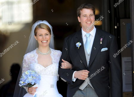 Groom Hubertus Michael Hereditary Prince of Saxony-coburg and Gotha and His Newly Wedded Wife Kelly Jeanne (nee Rondestvedt) Leave the Church After Their Wedding in Coburg Germany 23 May 2009 Some 400 Guests Many of Which Celebrities and European Aristocrats Attended the Wedding Germany Coburg