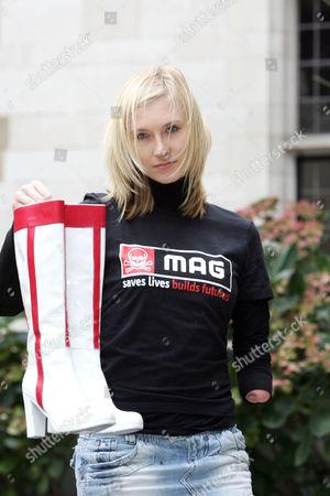 Kelly Knox holding Geri Halliwell's customised Prada boots.