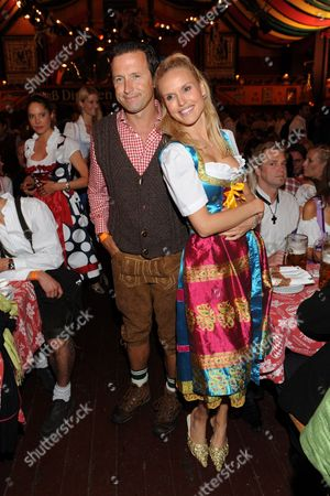 Stock Image of Tv Moderators Norbert Dobeleit (l) and Tamara Sedmak at the Oktoberfest in Munich 25 September 2010 Both Followed the Invitation of Former Tennis World No 1 Boris Beck who Earlier the Day Hosted a Charity Golf Tournament For His Clever-becker Foundation and Invited His Guests For the Evening to the Hippodrom One of the Most Famous Tents at the Munich Oktoberfest Which is Often Frequented by Celebrities Germany Munich