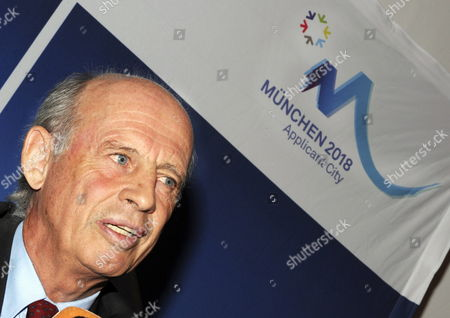 German Enterpriser Willy Bogner Sits Below a Logo of Munich's Application For the 2018 Olympic Games During a Press Conference in Munich Germany 06 November 2009 the Former Participant in the Olympic Games Became Chairman of the Executive Board of the Application Society Munich 2018 Munich's Planning Committee Disclosed in Munich Germany Munich