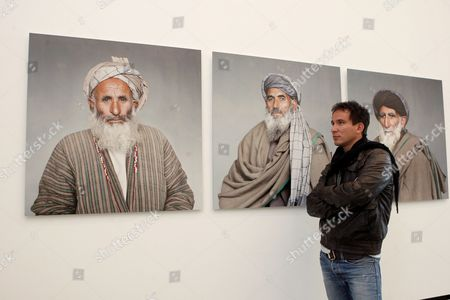 German Photographer Marcel Mettelsiefen Observes the Hanging of His Portraits of Afghan Relatives of Air-raid Victims on Display During the Exhibition 'Kunduz 4 September 2009' at Kunstraum Potsdam in Potsdam Germany 21 April 2010 the Victims Died in a German-ordered Airstrike in Afghanistan's Kunduz Region on 04 September 2009 For Several Months Mettelsiefen and Afghanistan Correspondent Christoph Reuter Investigated on These Victims the Exhibition Opens on 24 April and Runs Until 13 June 2010 Germany Potsdam