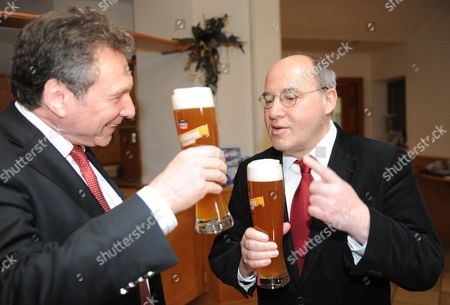 Chairman of the Left Party Gregor Gysi (r) and Party Leader Klaus Ernst Drink Beer During the 'Political Ash Wednesday' Event Initiated by the Party in Tiefenbach Germany 09 March 2011 Germany Tiefenbach