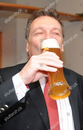 Chairperson of the Left Party Klaus Ernst Drinks Beer During the 'Political Ash Wednesday' Event Initiated by the Party in Tiefenbach Germany 09 March 2011 Germany Tiefenbach