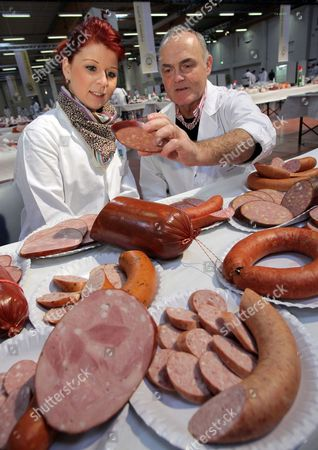 Stock Picture of Judges Diana Lein (l) and Werner Wenz (r) Eye Various Cooked an Boiled Sausages at the Test Centre of German Agricultural Society (dlg) in Bas Salzufflen Germany 02 March 2010 Some 6 500 Meat Goods by 600 Manufacturers Were Tested by 600 Experts on Quality Taste and Smell Germany Bad Salzuflen