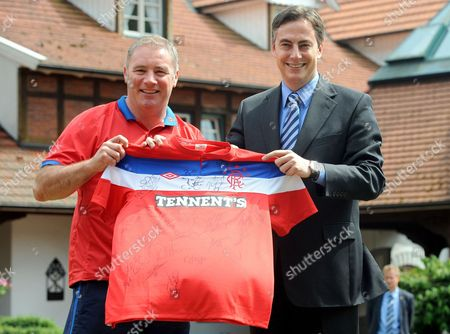 Stock Photo of The Head Coach of the Scottish Soccer Club Glasgow Rangers Alistair Mccoist (l) Hands Over a Jersey with the Team's Autographs to the Prime Minister of Lower Saxony David Mcallister in Herzlake Germany 10 July 2011 the Rangers Currently Hold Their Training Camp in the Ems Region Mcallister who Has Scottish Ancestors Took the Chance to Visit His Favourite Team Germany Herzlake
