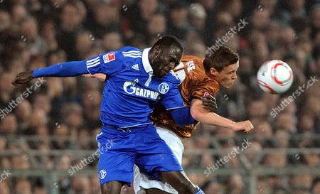 Fc Schalke 04's Hans Sarpei (l) and St Pauli's Max Kruse Challenge For the Ball During the German Bundesliga Soccer Match Fc St Pauli - Fc Schalke 04 in Hamburg Germany on 01 April 2011 (attention: Embargo Conditions! the Dfl Permits the Further Utilisation of the Pictures in Iptv Mobile Services and Other New Technologies Only No Earlier Than Two Hours After the End of the Match the Publication and Further Utilisation in the Internet During the Match is Restricted to Six Pictures Per Match Only ) Germany Hamburg