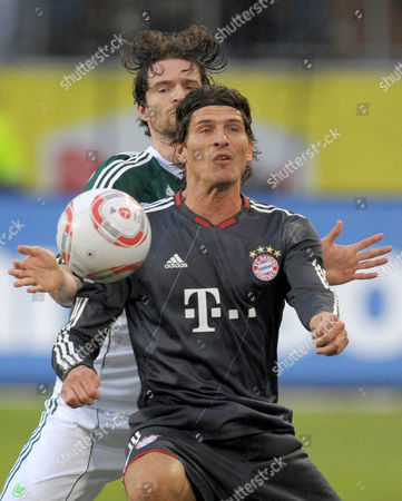 Soccer Bundesliga 18th Matchday: Vfl Wolfsburg Plays Fc Bayern Munich in the Volkswagen Arena in Munich ágermany 15 January 2011 Wolfsburg's Arne Friedrich (l) and Munich's Mario Gomez Vie For the Ball (attention:áembargoáconditions! the Dfl Permit the Further Utilisation of the Pictures in Iptv Mobile Services and Other New Technologies Only No Earlier Than Two Hours After the End of the Match the Publication and Further Utilisation in the Internet During the Match is Restricted to Six Pictures Only ) Epa/peter Steffen Epa/peter Steffen Germany Wolfsburg